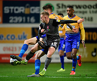 Lincoln City's Danny Rowe vies for possession with Mansfield Town's Ryan Sweeney<br /> <br /> Photographer Chris Vaughan/CameraSport<br /> <br /> The EFL Sky Bet League Two - Mansfield Town v Lincoln City - Monday 18th March 2019 - Field Mill - Mansfield<br /> <br /> World Copyright © 2019 CameraSport. All rights reserved. 43 Linden Ave. Countesthorpe. Leicester. England. LE8 5PG - Tel: +44 (0) 116 277 4147 - admin@camerasport.com - www.camerasport.com