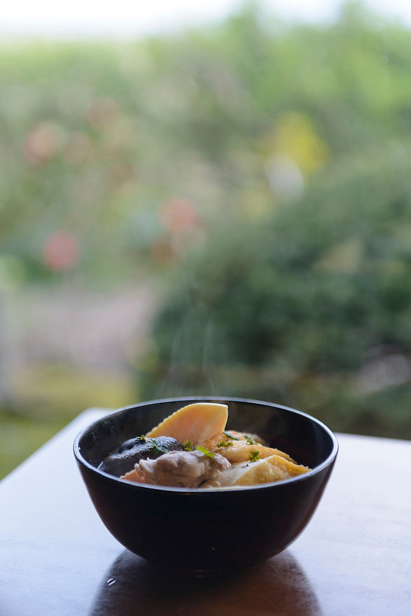 """""""Mousou-jiru"""" bamboo shoot soup. One of many dishes made with local mountain vegetables served at the Omoya Guesthouse. Tsuruoka, Yamagata Prefecture, Japan, April 10, 2016. The city of Tsuruoka in Yamagata Prefecture is famous for its sansai mountain vegetable cuisine. These foraged grasses, fungi and vegetables are also used by the mountain ascetics of the Shugendo religion."""