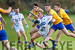 Fiachra Clifford Laune Rangers goes past Jonathan Kissane Mike Breen and Ger Hartnett Beaufort during their Mid Kerry semi Final in Beaufort on Saturday