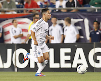 Vancouver Whitecaps FC midfielder Davide Chiumiento (20) dribbles down the wing. In a Major League Soccer (MLS) match, the New England Revolution defeated Vancouver Whitecaps FC, 4-1, at Gillette Stadium on May 12, 2012.
