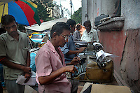 A man types with a manual type writer on a street of Kolkata. He types the documents of his customers on a freelance basis. He earns about 2 usd a day. Kolkata, West Bengal,  India  7/18/2007.  Arindam Mukherjee/Landov
