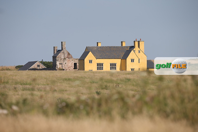 Sker House, a Grade I Listed Farmhouse and the site of a Cistercian Monastic grange sites close to the course, during Round One of the 2014 Senior Open Championship presented by Rolex from Royal Porthcawl Golf Club, Porthcawl, Wales. Picture:  David Lloyd / www.golffile.ie