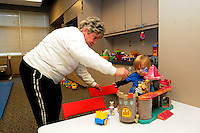 STAFF PHOTO FLIP PUTTHOFF <br /> Thelma Aguirre helps Van Bray play with a toy castle Wednesday Dec. 31 2014 during KIDcare at the Rogers Activity Center.