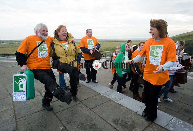 BatucaMob volunteers Tom Doherty and Frances Nagle step it  watched by Joan Tarmey to the sounds of The Kilfenora Ceili Band  at the Cliffs of Moher during the launch of European Week for Waste Reduction (EWRR) 2010. Photograph by John Kelly..
