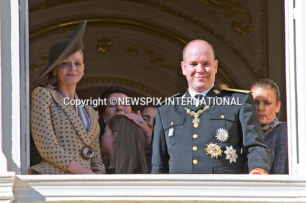 "Charlene Wittstock and Prince Albert II of Monaco; .MONACO NATIONAL DAY 2010 (Fête Nationale Monégasque 2010).The Royal Family greet the crowds and watch the Army Parade from the balcony of the Prince's palace as part of Monaco's National Day celebrations. Monaco_19/11/2010..Mandatory Photo Credit: ©Dias/Newspix International..**ALL FEES PAYABLE TO: ""NEWSPIX INTERNATIONAL""**..PHOTO CREDIT MANDATORY!!: NEWSPIX INTERNATIONAL(Failure to credit will incur a surcharge of 100% of reproduction fees)..IMMEDIATE CONFIRMATION OF USAGE REQUIRED:.Newspix International, 31 Chinnery Hill, Bishop's Stortford, ENGLAND CM23 3PS.Tel:+441279 324672  ; Fax: +441279656877.Mobile:  0777568 1153.e-mail: info@newspixinternational.co.uk"