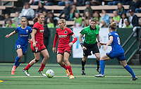 Seattle, Washington - Saturday May 14, 2016:  Portland Thorns FC midfielder Allie Long (10) with the ball during the first half of a match at Memorial Stadium on Saturday May 14, 2016 in Seattle, Washington. The match ended in a 1-1 draw.
