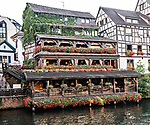View of the restaurant Au Pont St. Martin in early morning along the River Ill in Strasbourg, Alsace