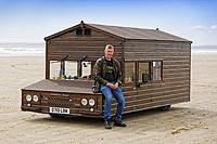 Pictured: Kevin Nicks with his Fastest Shed in Pendine, west Wales, UK. Saturday 12 May 2018<br /> Re: A motorised shed has broken its own land speed record on a Welsh beach as it hit over 100mph.<br /> The Fastest Shed smashed its previous 80mph (129km/h) record for the fastest shed at a land speed event at Pendine Sands in Carmarthenshire.<br /> Its owner, gardener Kevin Nicks said it was &quot;marvellous&quot; to hit 101.043mph (160 km/h) in what he said was the only road legal shed with an engine in the world.<br /> Mr Nicks, from Chipping Norton in Oxfordshire, created his bespoke shed on wheels, which now boasts a turbo-charged 450 brake horsepower turbo engine that is more powerful than many sports cars.