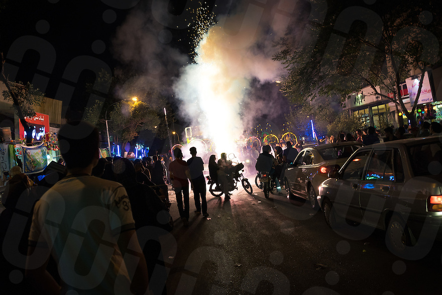 June 12, 2014 - Tehran (Iran). Fireworks a fired to celebrate the birthday of Imam Mahdi in a neighborhood in the south of Tehran. © Thomas Cristofoletti / Ruom