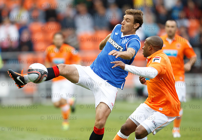 Nikica Jelavic hooks the ball upfield