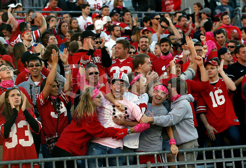 Ohio State students celebrate a touchdown by Ohio State Buckeyes running back Mike Weber (25) during the third quarter of the NCAA football game at Ohio Stadium in Columbus on Oct. 8, 2016. (Adam Cairns / The Columbus Dispatch)