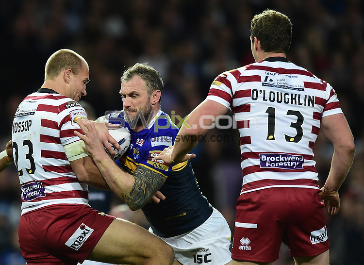 Picture by Alex Broadway/SWpix.com - 10/10/2015 - Rugby League - First Utility Super League Grand Final - Leeds Rhinos v Wigan Warriors - Old Trafford, Manchester, England - Jamie Peacock of Leeds Rhinos is tackled by Lee Mossop of Wigan Warriors.