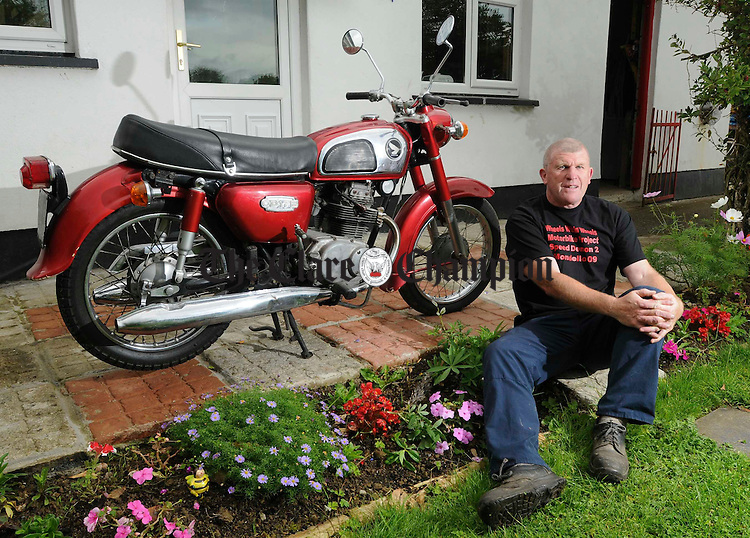Jacko Mc Mahon at home with his bike at Willow Park. Photograph by John Kelly.