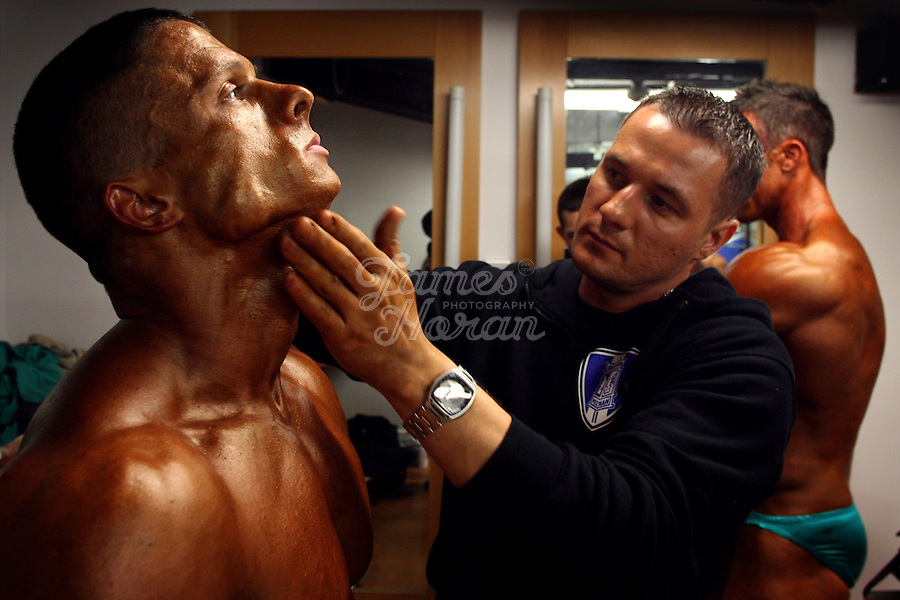 Middleweight - U80kg competitor and 2008 Mr Ireland, Polish born Dawid from Galway is pictured getting his fake tan applied backstage at the RIBBF (Republic of Ireland Body Building Federation) National Championships held in Limerick at the Millennium Theatre, LIT, Ireland