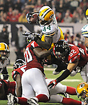 Green Bay Packers running back James Starks goes over the top of the pile of linebackers Curtis Lofton (50) and Coy Wire (52) against the Atlanta Falcons during the third quarter of the Divisional round playoff game at the Georgia Dome in Atlanta, Ga., on Saturday, Jan. 15, 2011.