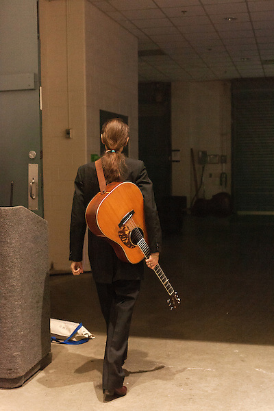 September 26, 2013. Raleigh, North Carolina.<br />  Tony Rice makes his way backstage before accepting his induction into the International Bluegrass Music Hall of Fame.<br />  Bluegrass guitar legend Tony Rice was inducted into the International Bluegrass Music Hall of Fame during the International Bluegrass Music Awards, held in Memorial Hall at the Duke Energy Center for the Performing Arts.