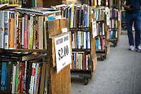 Racks of used books outside of a bookstore on Fourth Avenue, what was once Bookseller Row, in New York on Friday, July 31, 2015. (© Richard B. Levine)