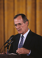 Washington DC., USA, 1989<br /> President George  H.W. Bush at microphone during news. conference. Credit: Mark Reinstein/MediaPunch