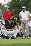 6 September 2008:  Left to right:  Steve Stricker, Camillo Villegas (seated) and Kenny Perry wait to tee off on the second hole on Saturday September 6, 2008 in the second round of play at the BMW Golf Championship at Bellerive Country Club in Town & Country, Missouri, a suburb of St. Louis, Missouri.  The BMW Championship is the third event on the PGA's Fed Ex Tour.  Villegas was the leader after the conclusion of first round play with a five-under par score.