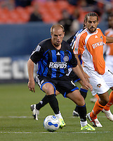 Colorado Rapids midfielder Clint Mathis and Houston midfielder Dwayne DeRosario. The Houston Dynamo beat the Colorado Rapids 1-0 on a goal by Brian Ching, April 29, 2006, at Invesco Field at Mile High Stadium in Denver, Colorado.