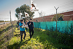 A group of people with basque flags and banners asking the repatriation of basque prisoners gets close to the prison's fence shout slogans to the basque prisoner in the penitentiary center. Caceres (Spain)February 20, 2016. Some friends and relatives of Basque political prisoners take part on a march to Caceres penitentiary center, within the campaign of 40 marches to 40 prisons where Basque prisoners are imprisoned. These marches are to denounce the dispersal policy those prisoners suffer since more than 25 years. (Gari Garaialde / Bostok Photo)