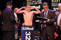 Sunny Edwards on the scales during a Weigh In at the BT Studios, Queen Elizabeth Olympic Park on 12th July 2019
