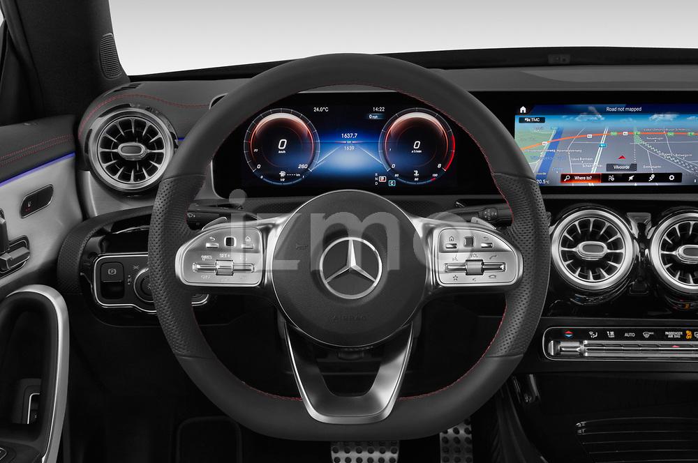 Car pictures of steering wheel view of a 2020 Mercedes Benz CLA AMG-Line 4 Door Sedan