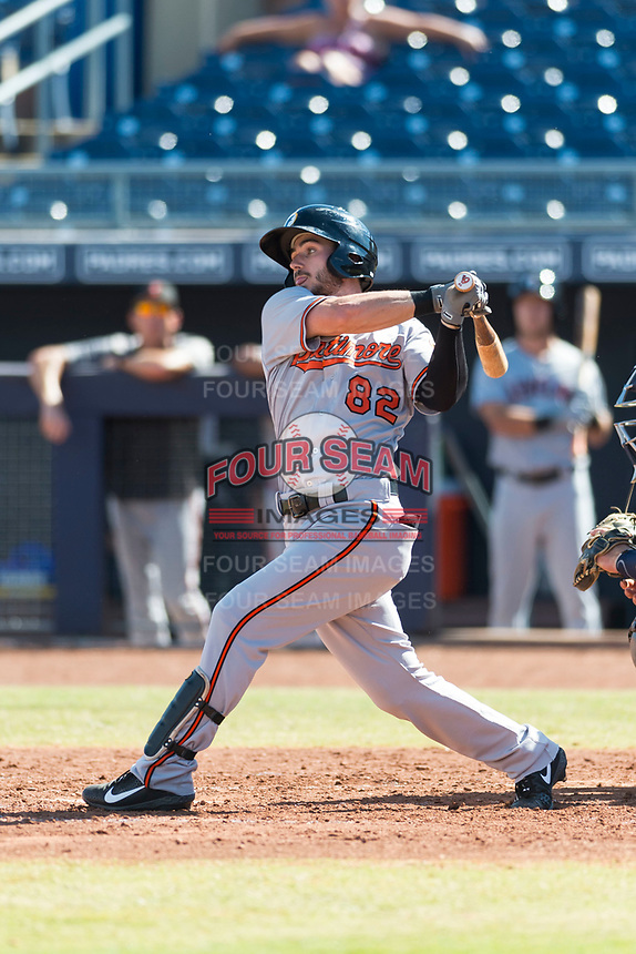 Glendale Desert Dogs center fielder Ryan McKenna (82), of the Baltimore Orioles organization, follows through on his swing during an Arizona Fall League game against the Peoria Javelinas at Peoria Sports Complex on October 22, 2018 in Peoria, Arizona. Glendale defeated Peoria 6-2. (Zachary Lucy/Four Seam Images)