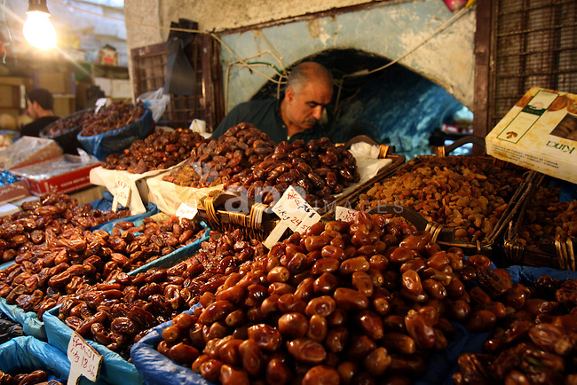 A Palestinian vendor sells dates in his shop at a market in the West Bank city of Nablus, on Aug. 10, 2011. Muslims around the world are observing the holy fasting month of Ramadan where they refrain from eating, drinking, smoking from dawn to dusk.  Photo by Wagdi Eshtayah