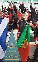 Joao Barbosa, a driver on the winning team, celebrates in Victory Lane after his team won the Rolex 24 at Daytona, January 31, 2010.  (Photo by Brian Cleary/www.bcpix.com)