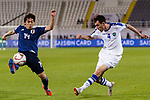 Farrukh Sayfiev of Uzbekistan (R) fights for the ball with Ito Junya of Japan (L) during the AFC Asian Cup UAE 2019 Group F match between Japan (JPN) and Uzbekistan (UZB) at Khalifa Bin Zayed Stadium on 17 January 2019 in Al Ain, United Arab Emirates. Photo by Marcio Rodrigo Machado / Power Sport Images