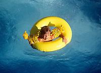 Boy in pool float.
