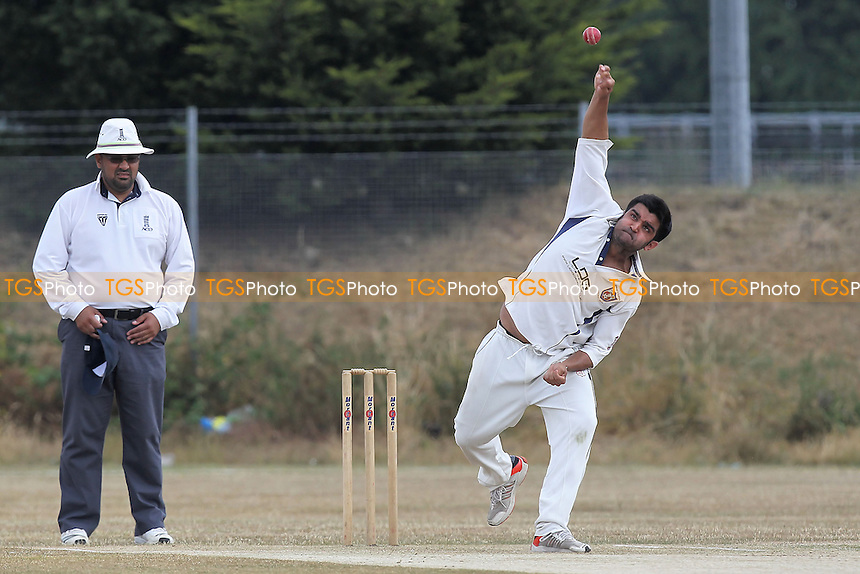 Z Sharif in bowling action for Hainault & Clayhall - Hainault & Clayhall CC vs Woodford Wells CC - Essex Cricket League - 13/07/13 - MANDATORY CREDIT: Gavin Ellis/TGSPHOTO - Self billing applies where appropriate - 0845 094 6026 - contact@tgsphoto.co.uk - NO UNPAID USE