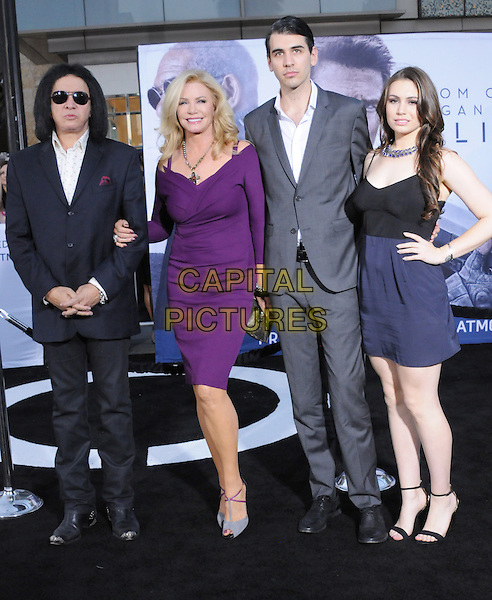 "Gene Simmons, Shannon Tweed, Nick Simmons, Sophie Simmons.""Oblivion"" Los Angeles Premiere held at the Dolby Theatre, Hollywood, California, USA..April 10th, 2013                                                                    .full length black suit purple dress grey gray blue dress couple daughter mother mom mum father dad family black sunglasses shades hand on hip.CAP/DVS.©DVS/Capital Pictures."