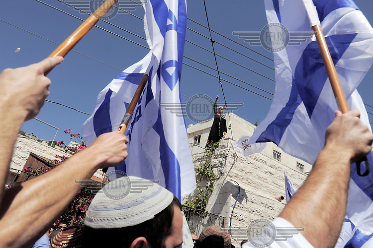 Ultra right-wing Jewish activists march in the Arab neighbourhood of Silwan. The activists are calling upon authorities to demolish illegal structures built by Palestinians in Silwan.