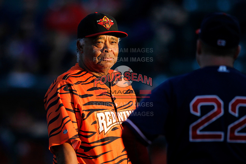 Rochester Red Wings coach Floyd Rayford exchanges the lineup card before a game against the Pawtucket Red Sox at Frontier Field on August 30, 2011 in Rochester, New York.  (Mike Janes/Four Seam Images)