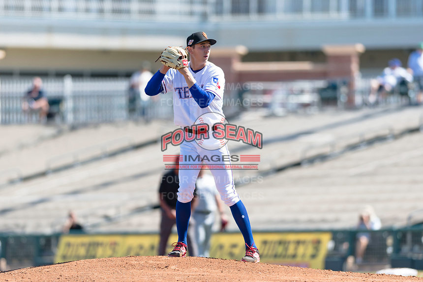 Surprise Saguaros starting pitcher Tai Tiedemann (62), of the Texas Rangers organization, gets ready to deliver a pitch during an Arizona Fall League game against the Peoria Javelinas at Surprise Stadium on October 17, 2018 in Surprise, Arizona. (Zachary Lucy/Four Seam Images)