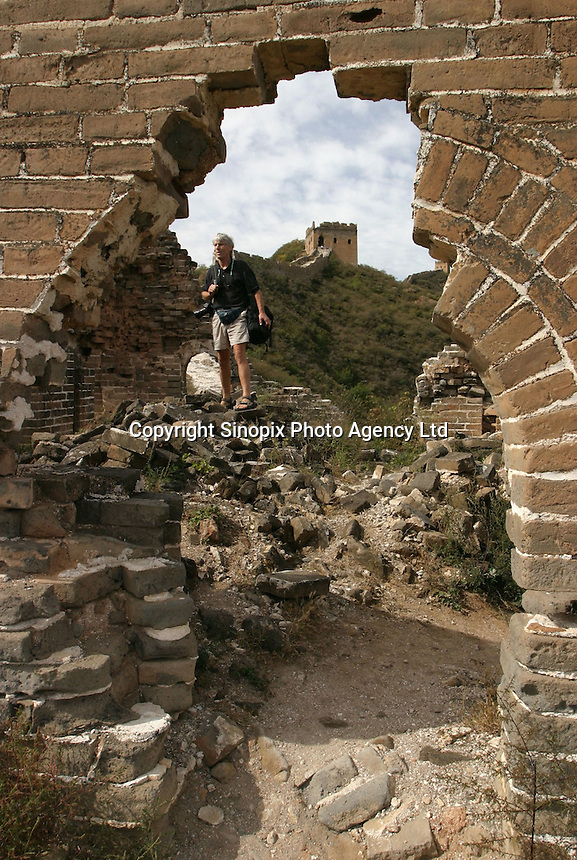 Tourists visit the Great Wall in Beijing, China. The Great Wall is a ruin in many places and hiking has been banned along some parts..
