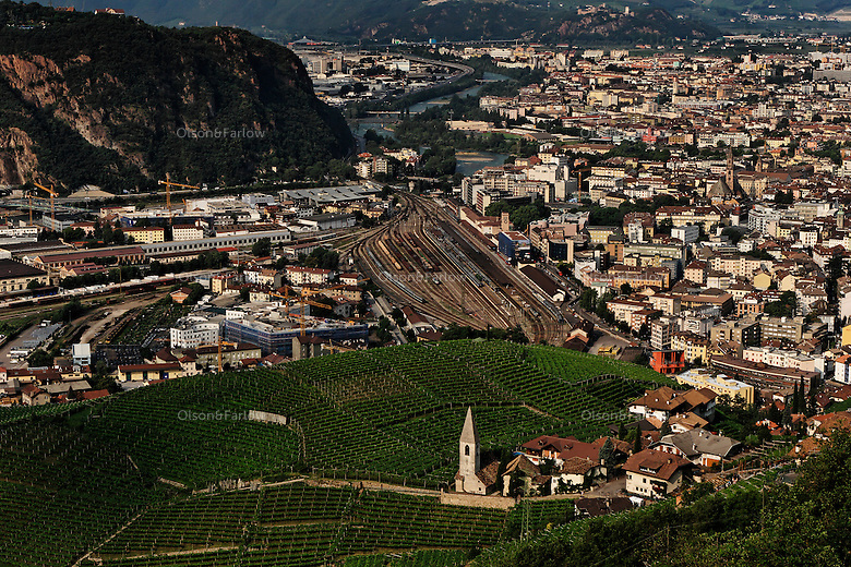 St Magdalena surrounded by vineyards is surrounded by powerlines on the hillsides, sprawling highways, industry, railways and the spreading city of Balzano.  Urban pressures chip away at the charm of many cities in the Alps.