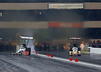 Jul 11, 2015; Joliet, IL, USA; NHRA top fuel driver Clay Millican (left) goes sideways alongside Leah Pritchett during qualifying for the Route 66 Nationals at Route 66 Raceway. Mandatory Credit: Mark J. Rebilas-USA TODAY Sports