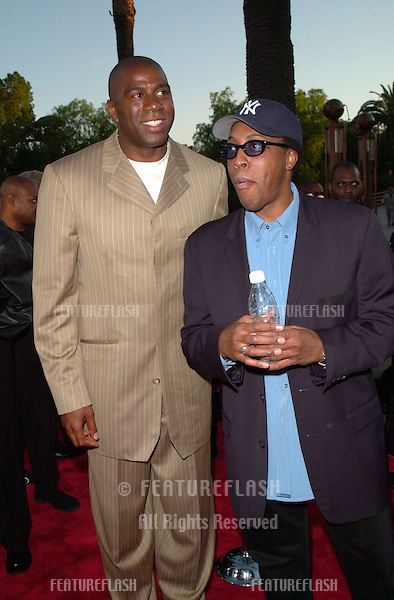 Former basketball star EARVIN MAGIC JOHNSON (left) & TV presenter ARSENIO HALL at the world premiere, at the Universal Amphitheatre Hollywood, of Nutty Professor II: The Klumps.