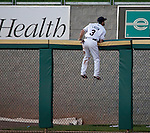 Reno Aces right fielder Adam Eaton climbs the fence and watchs a home run by Sacramento River Cats Michael Taylor during their game on Monday night July 30, 2012 at Aces Ballpark in Reno, Nevada.