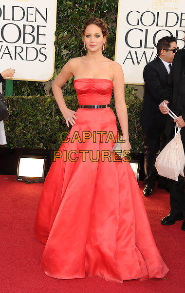 Jennifer Lawrence.Arrivals at the 70th Annual Golden Globe Awards held at the Beverly Hilton Hotel, Hollywood, California, USA..January 13th, 2013.globes full length red strapless dress black belt hand on hip clutch bag silver .CAP/GAG.©GAG/Capital Pictures