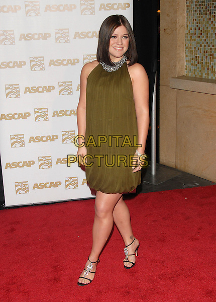 KELLY CLARKSON.Attends The ASCAP Pop Awards held at The Kodak Theatre in Hollywood, California on .April 18th, 2007.full length green olive dress tattoo black shoes silver beads beaded collar buttons .CAP/DVS.©Debbie VanStory/Capital Pictures