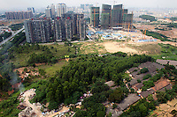Old houses are gradually being cleared to make way for new residential complexes in the city of Nanning. /Felix Features