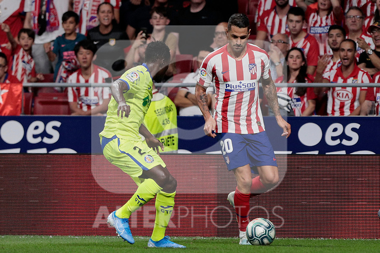 Atletico de Madrid's Victor Machin 'Vitolo' and Getafe CF's Djene Dakoman during La Liga match between Atletico de Madrid and Getafe CF at Wanda Metropolitano Stadium in Madrid, Spain. August 18, 2019. (ALTERPHOTOS/A. Perez Meca)