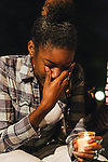 WASHINGTON, DC - SEPTEMBER 16:  Brittany Carter of Bowie, MD. is overcome with emotion during a vigil at Freedom Plaza in Washington, D.C. on Sept. 16, 2013. The vigil, during which organizers called for stricter gun laws, was in remembrance of the more than 10 killed in a shooting at the Navy Yard earlier in the day.   (Photo by Greg Kahn/Getty Images)