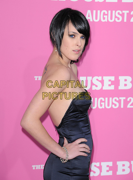 "RUMER WILLIS .The Columbia Pictures' Premiere of ""House Bunny"" held at The Mann Village Theatre in Westwood, California, USA..August 20th, 2008.half length black strapless dress hand on hip bracelet .CAP/DVS.©Debbie VanStory/Capital Pictures."