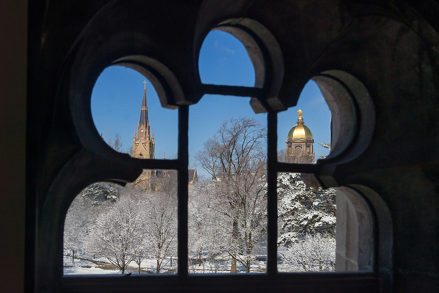 Mar. 12, 2014; Basilica steeple and Dome as seen through a window.<br /> <br /> Photo by Matt Cashore/University of Notre Dame