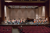 Allen Gross leads the Occidental/Caltech Orchestra during rehearsal on the stage of Thorne Hall on Nov. 30, 2012. (Photo by Marc Campos, Occidental College Photographer)
